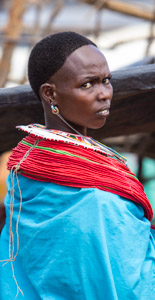A young women with red beads