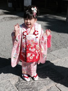 A young Japanese girl celebrating her 3rd birthday in traditional dress at Tsurugaoka Hachiman-gū, Kamakura, Japan